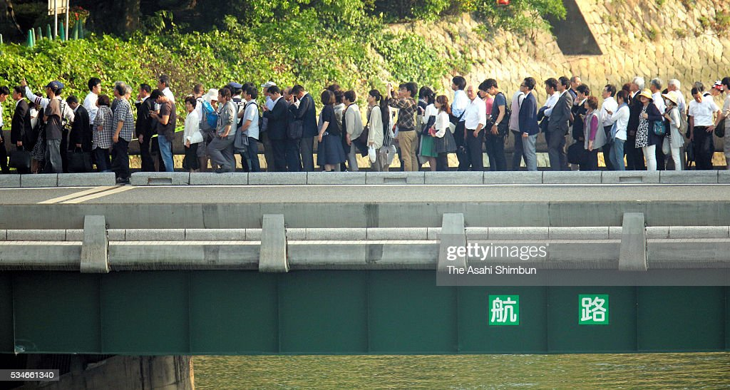 pedestrian queue as a road is closed in preparation for the visit by U.S. President Barack Obama on May 27, 2016 in Hiroshima, Japan. Obama becomes the first sitting U.S. president to visit Hiroshima, where the first atomic bomb was dropped in 1945 at the end of World War II.