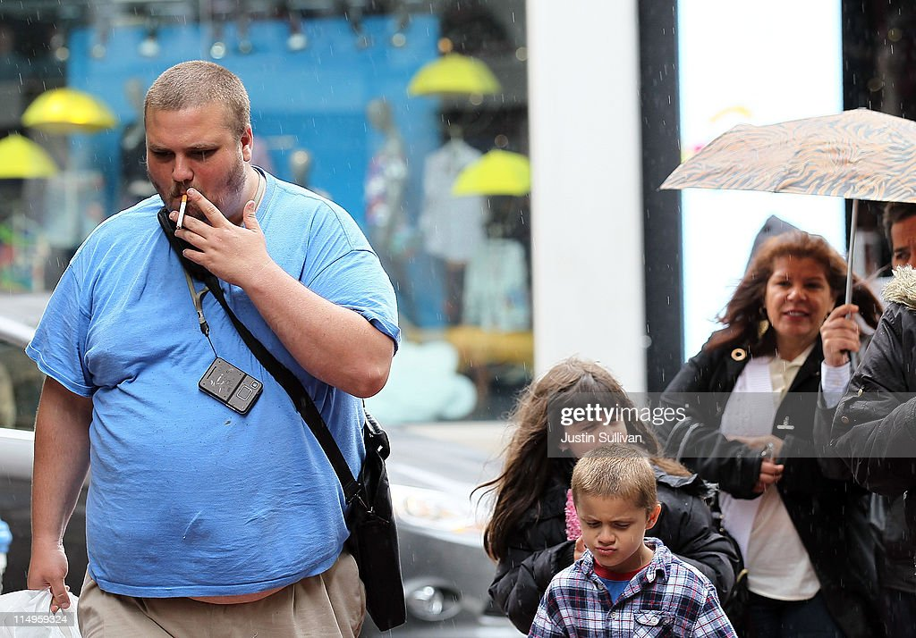 A pedestrian smokes a cigarette while walking along Powell Street on May 31, 2011 in San Francisco, California. Since 1987, the World Health Organization has celebrated 'World No Tobacco Day' to raise awareness to the health risks associated with smoking tobacco. Smoking is the second biggest cause of death globally and is responsible for the death of one in ten adults worldwide.