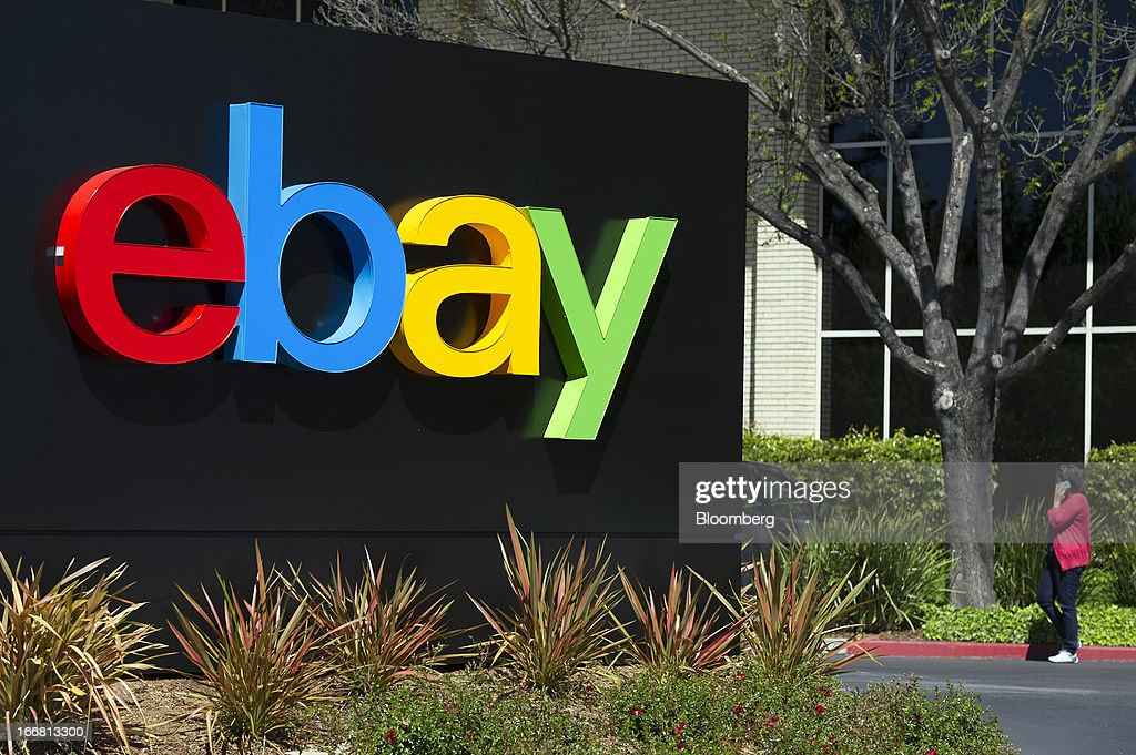 A pedestrian speaks on her cell phone next to eBay Inc. signage outside of the company's headquarters in San Jose, California, U.S., on Tuesday, April 16, 2013. Ebay Inc. is expected to release earnings data on April 17. Photographer: David Paul Morris/Bloomberg via Getty Images