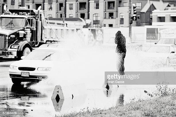 Pedestrian splashed by moving car