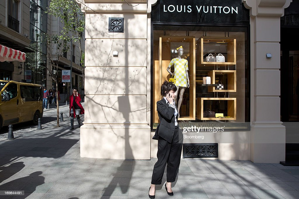 A pedestrian stands and speaks on a mobile phone outside a Louis Vuitton store, operated by LVMH Moet Hennessy Louis Vuitton SA, in the Nisantasi district of Istanbul, Turkey, on Thursday, April 4, 2013. Turkey's gross domestic product expanded 2.2 percent in 2012, down from 8.8 percent the previous year, according to data released by the statistics office in Ankara on April 1. Photographer: Kerem Uzel/Bloomberg via Getty Images