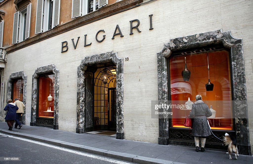 A pedestrian stands with her dog as she looks at the window display of the Bulgari SpA store, a luxury unit of LVMH Moet Hennessy Louis Vuitton SA, in Rome, Italy, on Monday, Nov. 19, 2012. Last year's acquisition of Bulgari 'has brought a lot of jewelry know-how' to the company, said Francesco Trapani, president of LVMH's watch and jewelry division, who joined the Paris- based luxury-goods maker as part of the deal. Photographer: Alessia Pierdomenico/Bloomberg via Getty Images