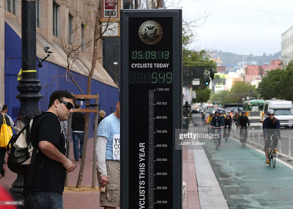 A pedestrian stops to look at an automated real-time bike counter on Market Street on May 9, 2013 in San Francisco, California. The San Francisco Municipal Transportation Agency has installed an automated real-time bike counter, also known as a bicycle barometer, on Market Street that will display daily and annual counts. According to the SFMTA, the number of cyclists on the streets of San Francisco has surged 71 percent between 2006 and 2011.