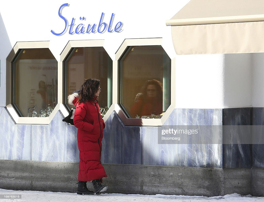 A pedestrian stops to look at luxury goods on display in the window of the Stauble watch store in the town of Davos, Switzerland, on Saturday, Jan. 19, 2013. Next week the business elite gather in the Swiss Alps for the 43rd annual meeting of the World Economic Forum in Davos, the five day event runs from Jan. 23-27. Photographer: Chris Ratcliffe/Bloomberg via Getty Images