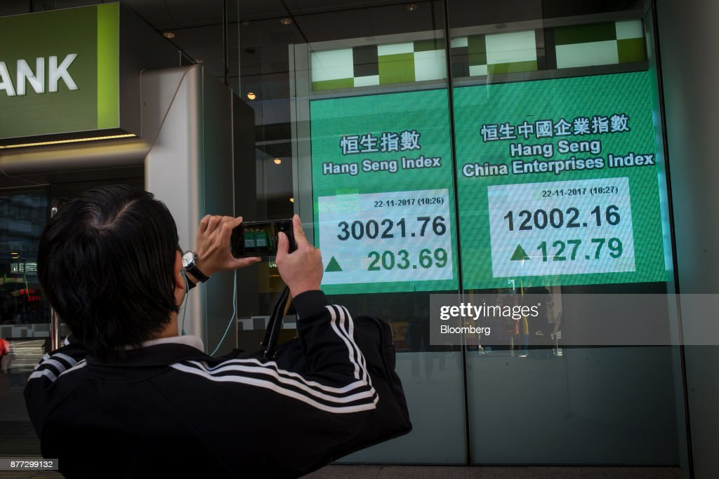 Images of Electronic Stock Boards As Hong Kong's Hang Seng Index Rises Above 30,000 to Decade-High