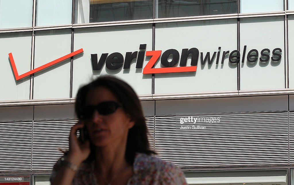 A pedestrian talks on a cellular phone as she walks by a Verizon Wireless store on April 19, 2012 in New York City. With strong holiday sales of the iPhone 4GS and a surge in customer billing Verizon reported first quarter earnings of $1.69 billion, or 59 cents per share compared to $1.44 billion, or 51 cents per share one year ago.