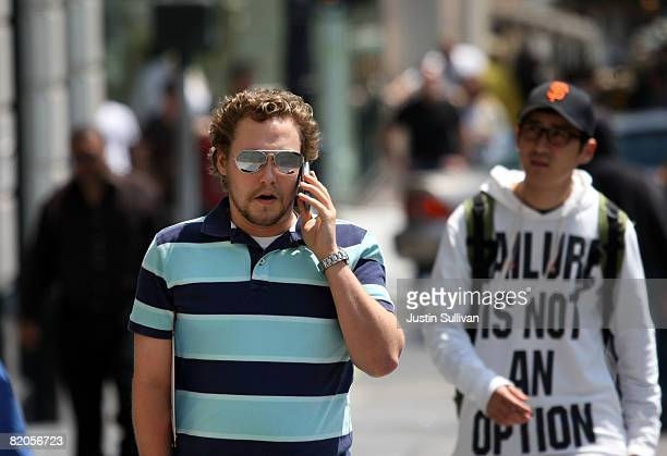 A pedestrian talks on his cellular phone as he walks down the street July 24 2008 in San Francisco California Dr Ronald B Herberman director of the...