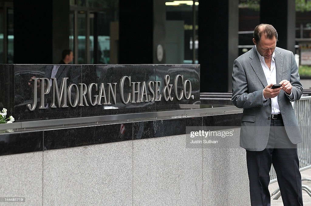 A pedestrian uses his cell phone by a sign outside of the JPMorgan Chase headquarters on May 14, 2012 in New York City. Following a $2 billion trading blunder, JPMorgan Chase's chief investment officer Ina Drew retired and will be succeeded by Matt Zames, an executive from JPMorgan's investment bank. At least two others are also being held accountable for the mistake.