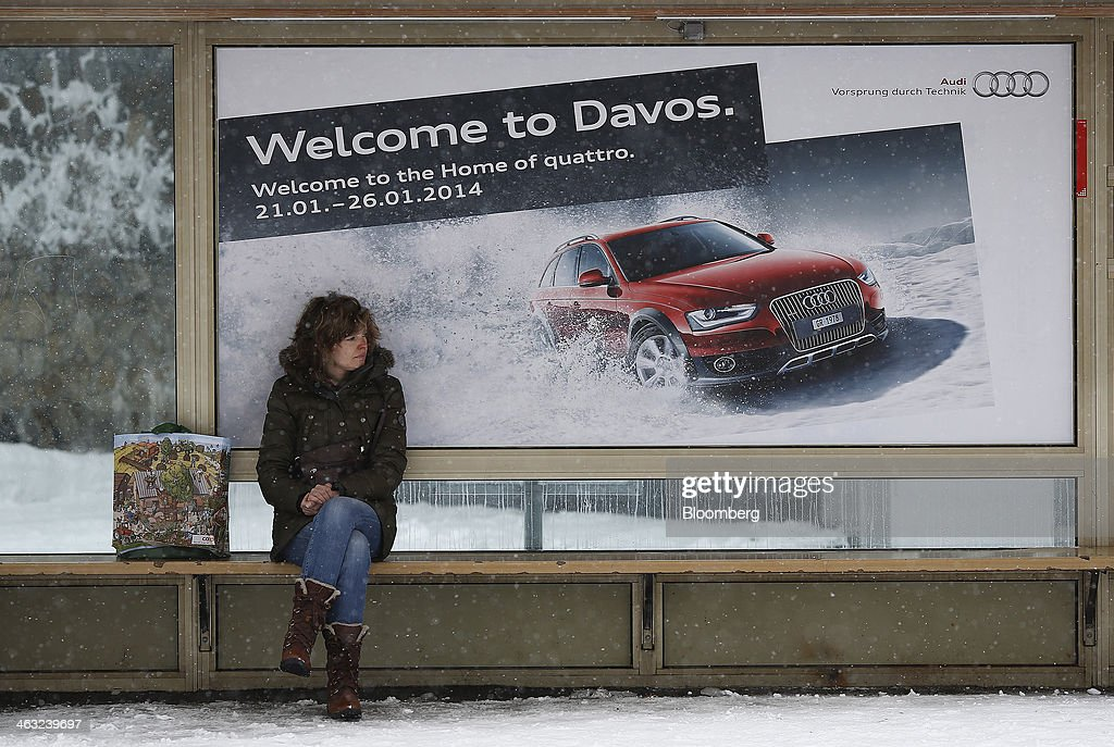 A pedestrian waits for a bus in Davos, Switzerland, on Friday, Jan. 17, 2014. Next week the business elite will gather in the Swiss Alps for the 44th annual meeting of the World Economic Forum (WEF) in Davos for the five day event which runs from Jan. 22-25. Photographer: Simon Dawson/Bloomberg via Getty Images