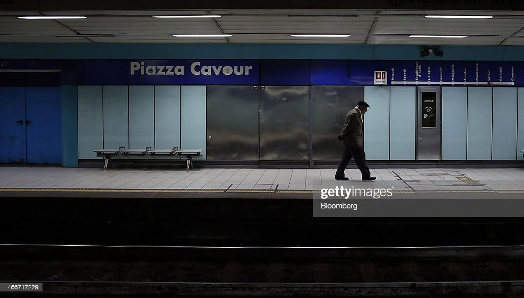 A pedestrian waits for a subway train on the platform of Piazza Cavour underground station in Naples, Italy, on Saturday, Feb. 1, 2014. In Naples, the local youth unemployment rate in 2012 was 53.6 percent compared to a national average of 35.3 percent. Photographer: Alessia Pierdomenico/Bloomberg via Getty Images