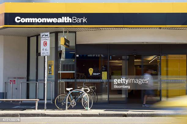 A pedestrian walk past a Commonwealth Bank of Australia branch in Melbourne Australia on Friday May 1 2015 Commonwealth Bank is the nation's largest...