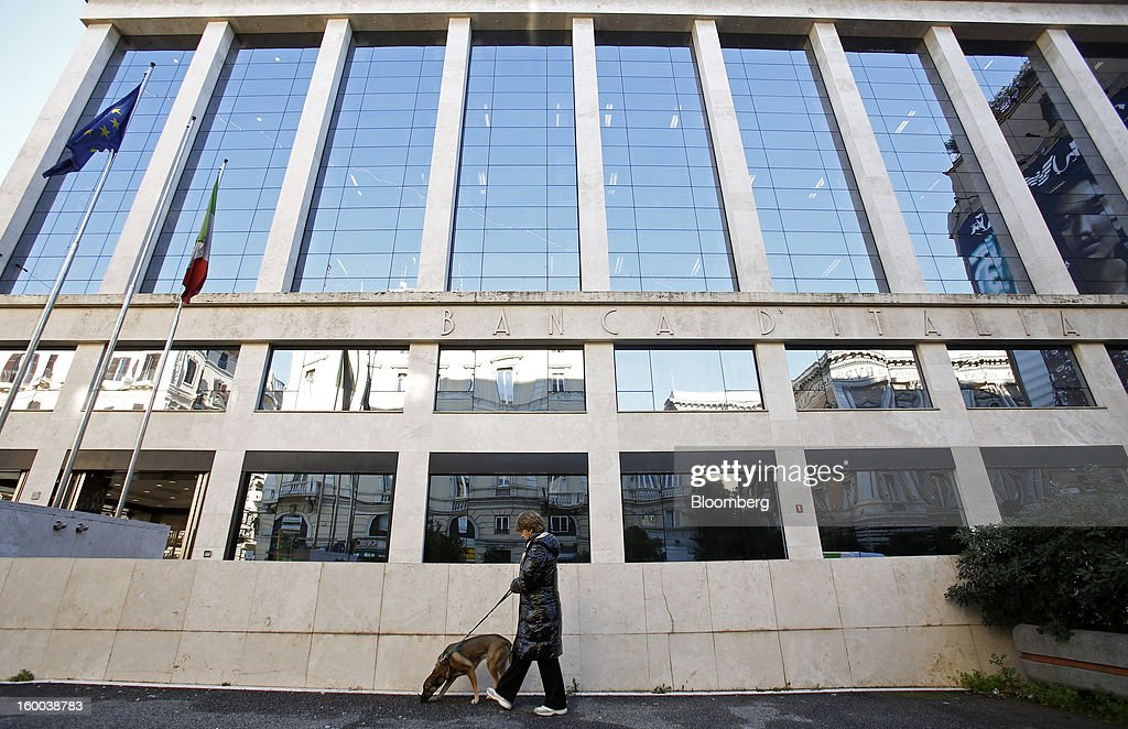A pedestrian walks a dog past the Banca d'Italia, Italy's central bank, in Rome, Italy, on Friday, Jan. 25, 2013. Italian Prime Minister Mario Monti said the Bank of Italy will take another look at Banca Monte dei Paschi di Siena SpA's books after the company disclosed this week it may face more than 700 million euros of losses related to structured finance transactions hidden from regulators. Photographer: Alessia Pierdomenico/Bloomberg via Getty Images