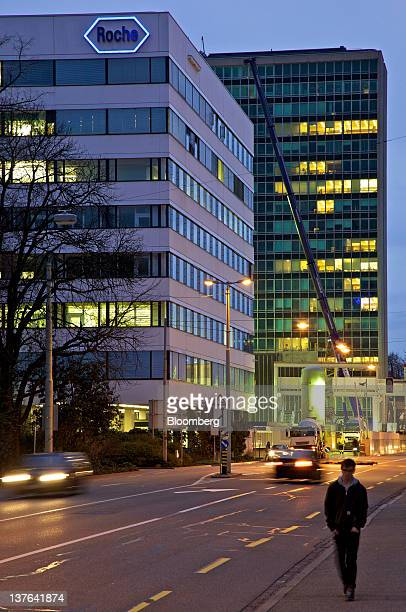 A pedestrian walks along a side walk near Roche Holding AG's headquarters in Basel Switzerland on Monday Jan 23 2012 US regulators approved Roche's...