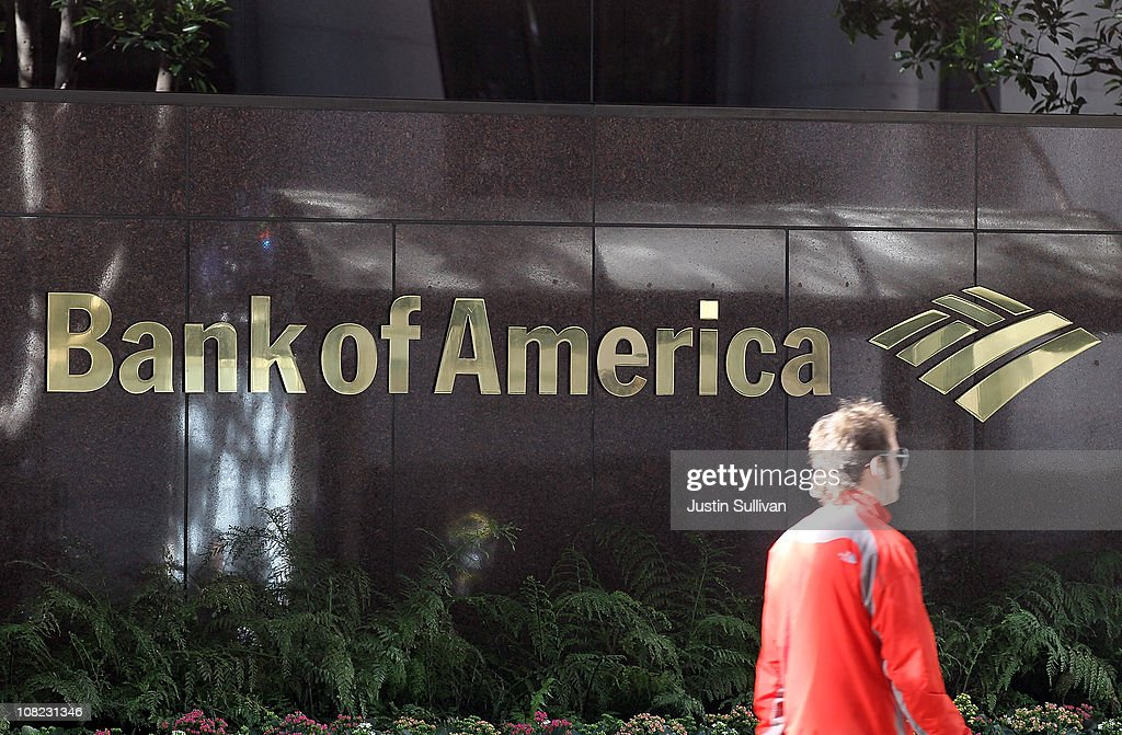 A pedestrian walks by a Bank of America branch office on January 21, 2011 in San Francisco, California. Bank of America reported a fourth quarter loss of $1.2 billion, or 16 cents a share, bringing total losses for the year to $2.23 billion, or 37 cents a share.