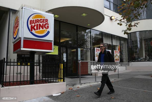 A pedestrian walks by a Burger King restaurant on August 1 2014 in San Francisco California Fastfood chain Burger King reported a 19 percent surge in...
