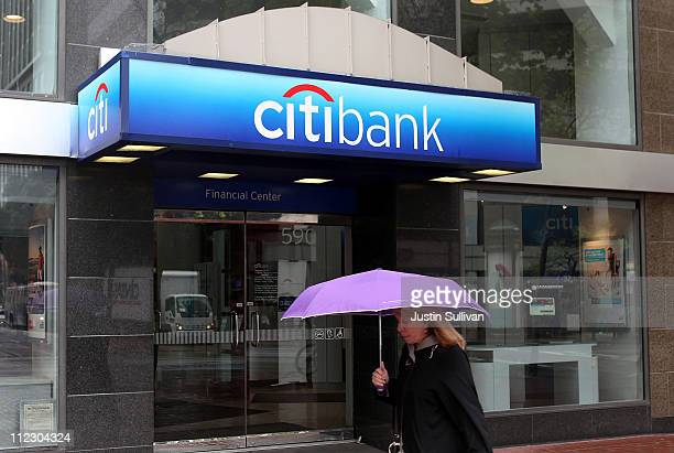 A pedestrian walks by a CitiBank branch office on April 18 2011 in San Francisco California Citigroup's firstquarter profit dropped 32 percent with...