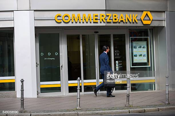 A pedestrian walks by a Commerzbank AG bank branch in Frankfurt Germany on Monday July 4 2016 The British seat at the European Union summit had been...