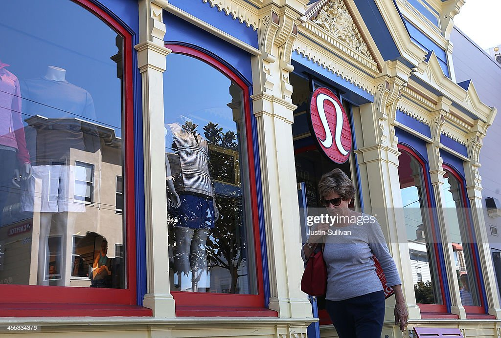 A pedestrian walks by a Lululemon retail store on September 12 2014 in San Francisco California Athletic clothing retailer Lululemon Athletica Inc...
