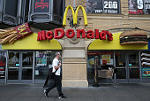 A pedestrian walks by a McDonald's restaurant on April 22 2015 in San Francisco California McDonald's reported a decline in first quarter revenues...