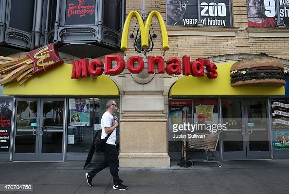 A pedestrian walks by a McDonald's restaurant on April 22 2015 in San Francisco California McDonald's reported a decline in first quarter revenues...