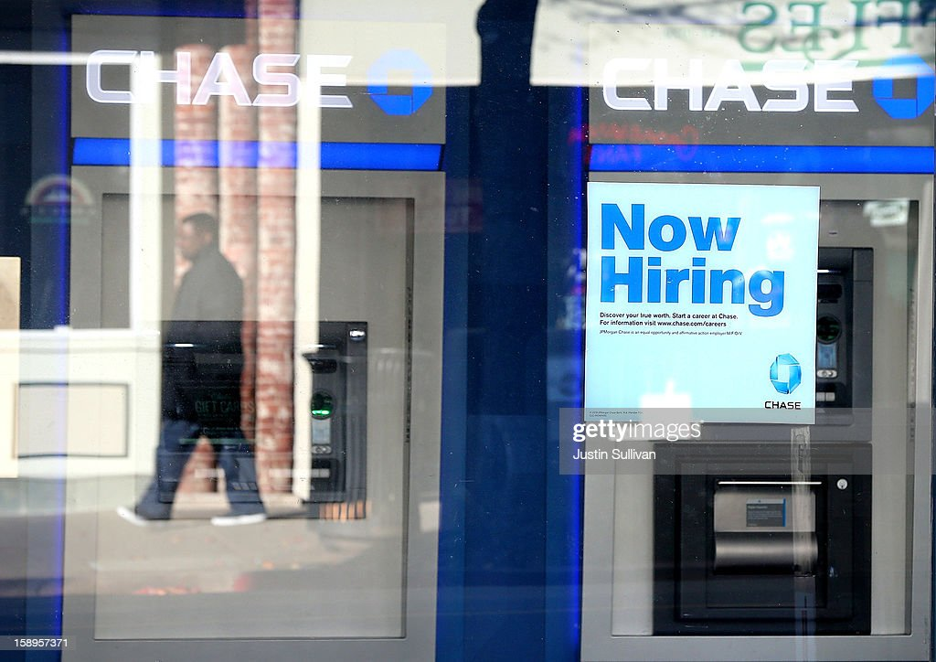 A pedestrian walks by a 'now hiring' sign that is posted in the window of a Chase bank branch on January 4, 2013 in San Rafael, California. According to a Labor Department December jobs report, the U.S. unemployment remained the same from November at 7.8% as employers added 155,000 jobs in December.