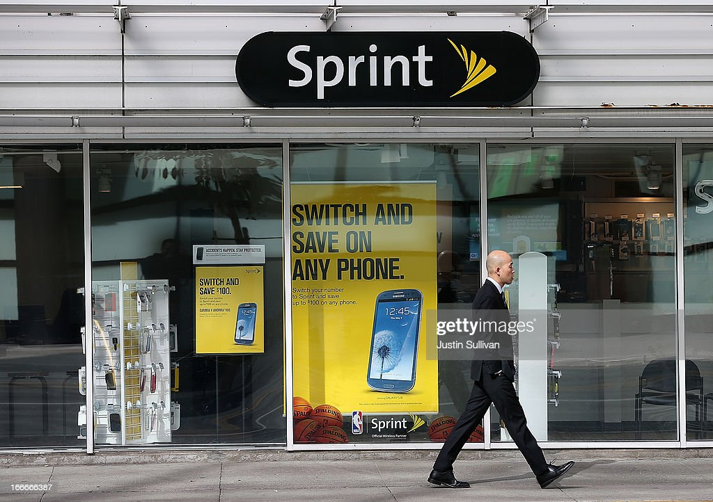 A pedestrian walks by a Sprint store on April 15, 2013 in San Francisco, California. Dish Network Corp has offered to purchase Sprint Nextel Corp for $25.5 billion in cash and stock.