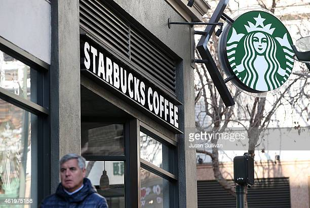 A pedestrian walks by a Starbucks Coffee shop on January 22 2015 in San Francisco California Starbucks will report first quarter earnings January 22...