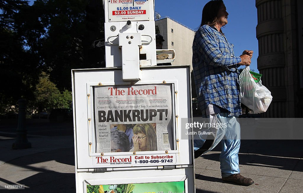 A pedestrian walks by a Stockton Record newspaper rack displaying the headline 'Bankrupt!' on June 27, 2012 in Stockton, California. Members of the Stockton city council voted 6-1 on Tuesday to adopt a spending plan for operating under Chapter 9 bankruptcy protection following failed talks with bondholders and labor unions failed. The move will make Stockton the biggest U.S. city to file for bankruptcy protection from creditors.