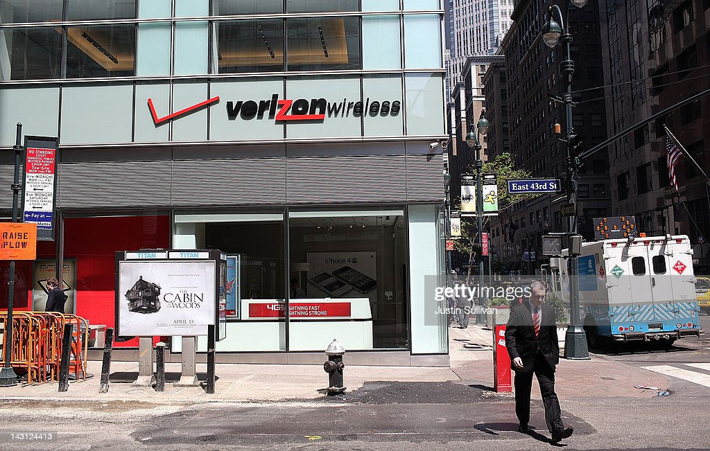 A pedestrian walks by a Verizon Wireless store on April 19, 2012 in New York City. With strong holiday sales of the iPhone 4S and a surge in customer billing Verizon reported first quarter earnings of $1.69 billion, or 59 cents per share compared to $1.44 billion, or 51 cents per share one year ago.