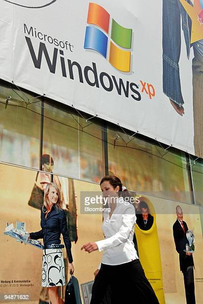 A pedestrian walks by an advertisement for Microsoft Windows XP in Frankfurt Germany Thursdsay June 16 2005 Microsoft Corp the world's biggest...