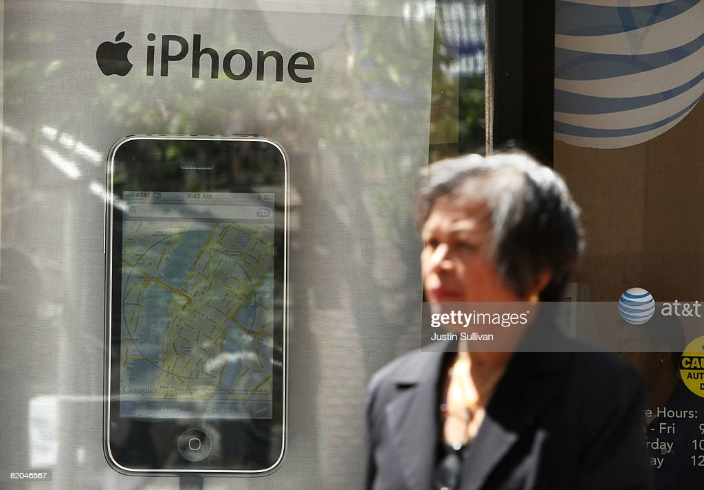 A pedestrian walks by an advertisement for the Apple iPhone displayed in the window of an AT&T Wireless store July 23, 2008 in San Francisco, California. AT&T reported a 30 percent increase in second quarter earnings today citing storing sales of the Apple iPhone. The company earned $3.77 billion, or 63 cents per share compared to $2.90 billion, or 47 cents per share, one year ago.