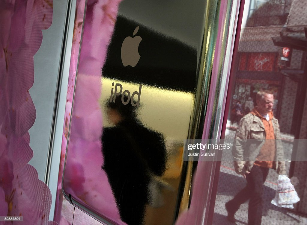 A pedestrian walks by an Apple iPod window display at an Apple Store April 23, 2008 in San Francisco, California. Apple reported its second quarter profits today as $1.05 billion, a 43 percent increase as compared to last year.