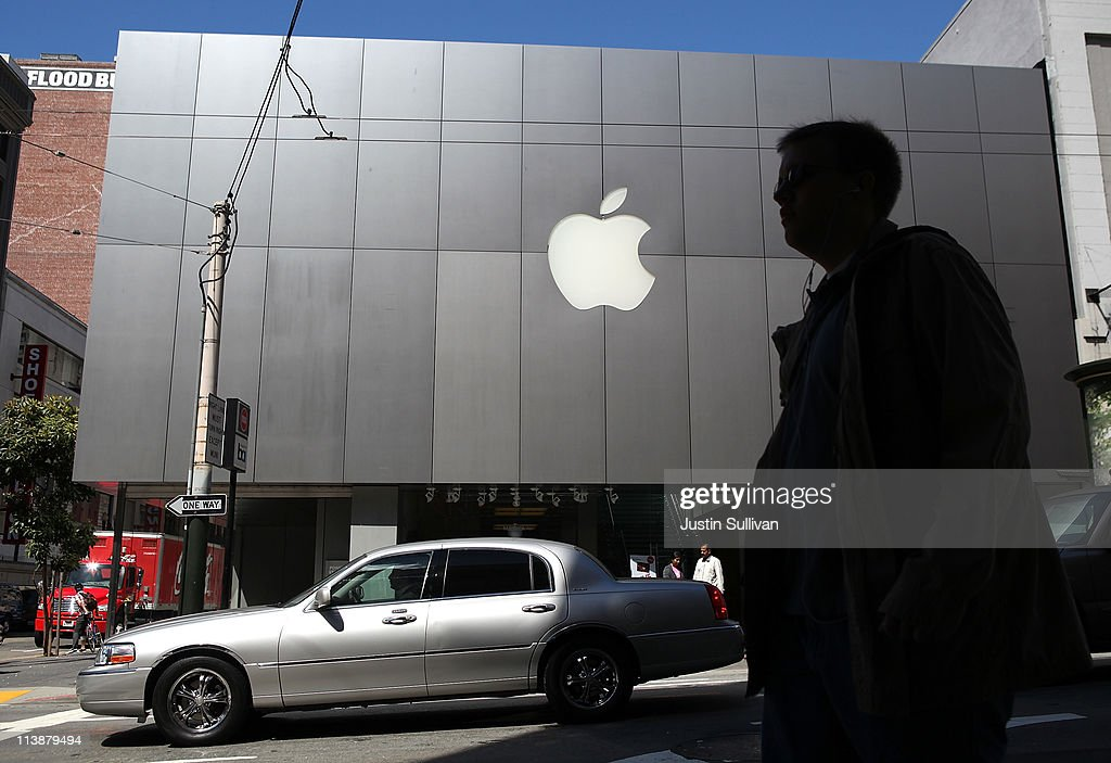 A pedestrian walks by an Apple Store following an announcement that Apple has become the world's most valuable brand on May 9, 2011 in San Francisco, California. In a report released by London based Millward Brown, Apple Inc. has surpassed Google to claim the top spot in a global ranking of brand value this year with an estimated value of more than $153 billion up 84 percent from last year.
