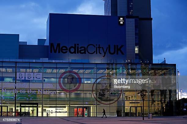 A pedestrian walks by at MediaCityUK in Salford Quays Manchester UK on Friday May 2015 Since the Conservatives won the general election UK Chancellor...