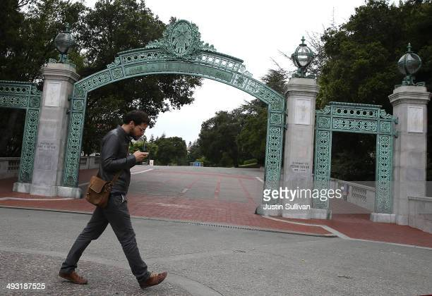 A pedestrian walks by Sather Gate on the UC Berkeley campus on May 22 2014 in Berkeley California According to the Academic Ranking of World...