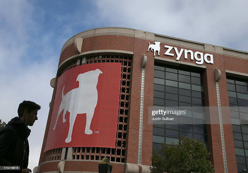 A pedestrian walks by the Zynga headquarters on July 25, 2013 in San Francisco, California. Online game maker Zynga will report second quarter earnings after the market close.