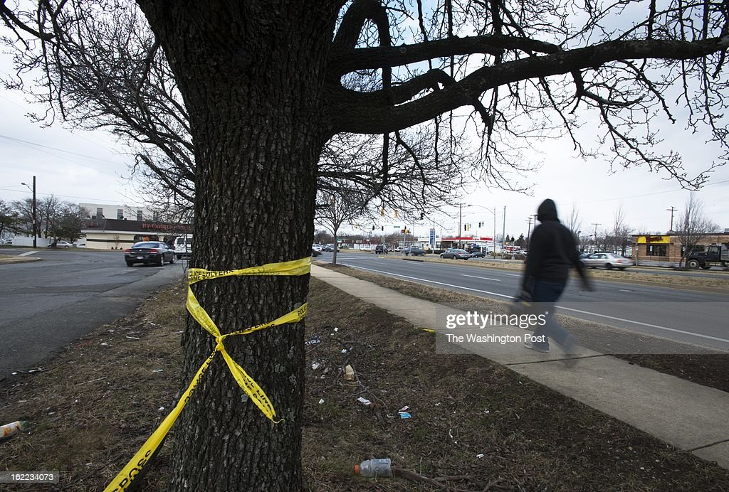COUNTY, MD -A pedestrian walks down Branch Ave. near the intersection of Colebrook Rd. where a man was fatally shot on Feb.19 in Prince Georges Co., MD. Several people have been shot -- including two teens, fatally -- in PG County in recent days.