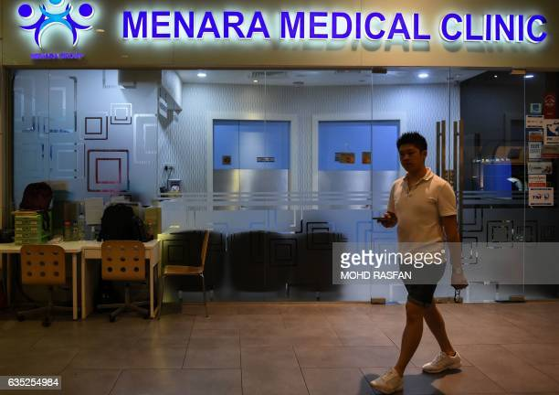 A pedestrian walks in front of a clinic where a North Korean man suspected to be Kim JongNam halfbrother of North Korean leader Kim JongUn is...
