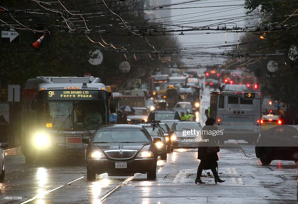 A pedestrian walks in the rain on December 11 2014 in San Francisco California The San Francisco Bay Area is being hit with a severe storm that is...