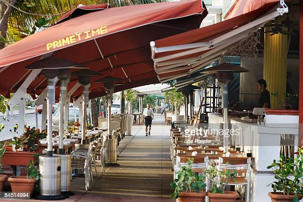 A pedestrian walks near restaurants on the famed Ocean Drive strip on January 28 2009 in Miami Beach Florida As the economic downturn continues the...