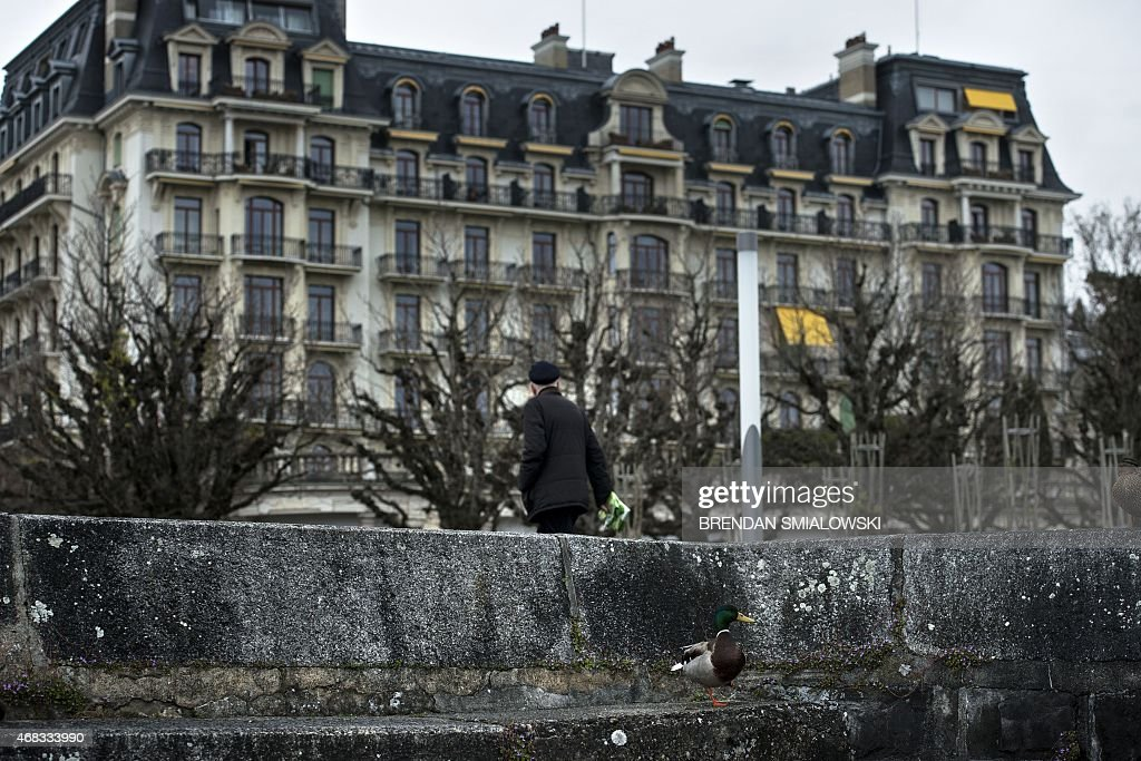 A Pedestrian Walks Near The Beau Rivage Palace Hotel During An Extended Round Of Nuclear Talks