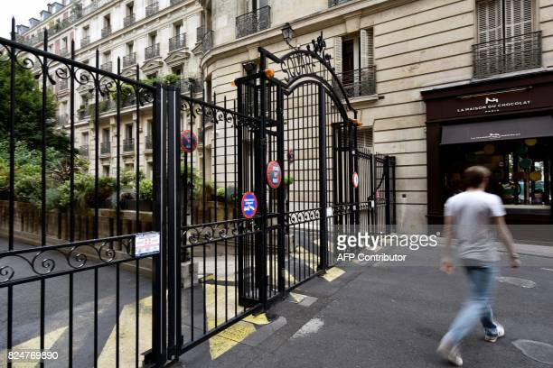 A pedestrian walks near the home of French actress Jeanne Moreau in Paris on July 31 after her death at the age of 89 was announced French actress...