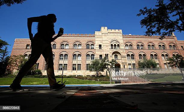 A pedestrian walks near the Humanties Building on the UCLA campus in Westwood on June 20 2013