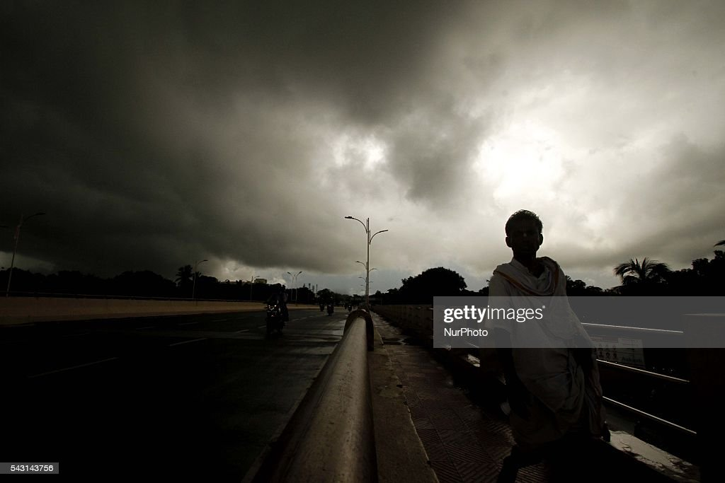 A pedestrian walks on an overpass as monsoon rain clouds hovering in the sky before downpour in the eastern Indian city Bhubaneswar, India, Sunday, 26 June 2016.A pedestrian walks on an overpass as monsoon rain clouds hovering in the sky before downpour in the eastern Indian city Bhubaneswar, India, Sunday, 26 June 2016.