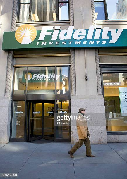 A pedestrian walks outside a Fidelity branch in New York US on Tuesday Feb 24 2009 Fidelity Investments Charles Schwab Corp and other 401 account...