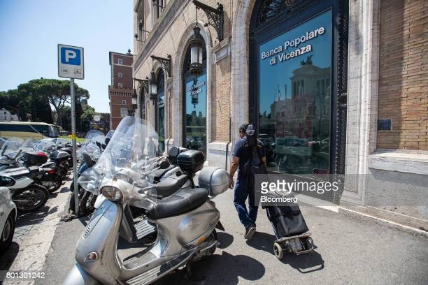 A pedestrian walks past a Banca Popolare di Vicenza SpA bank branch in Rome Italy on Monday June 26 2017 Italy orchestrated its biggest bank rescue...