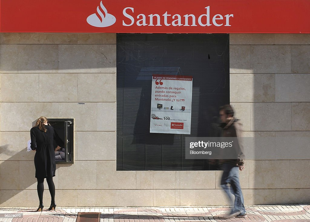 A pedestrian walks past a branch of Banco Santander in Madrid, Spain, on Wednesday, Feb. 3, 2010. Banco Santander announce FY earnings tomorrow. Photographer: Denis Doyle/Bloomberg via Getty Images