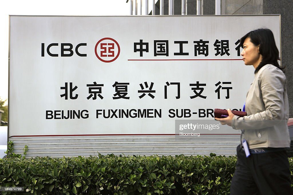 A pedestrian walks past a branch of the Industrial and Commercial Bank of China Ltd. (ICBC) in Beijing, China, on Monday, Oct. 29, 2012. ICBC is expected to announce third-quarter results on Oct. 30. Photographer: Nelson Ching/Bloomberg via Getty Images