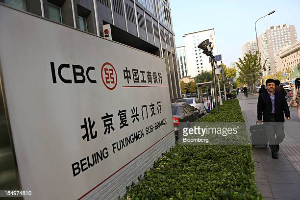 A pedestrian walks past a branch of the Industrial and Commercial Bank of China Ltd in Beijing China on Monday Oct 29 2012 ICBC is expected to...