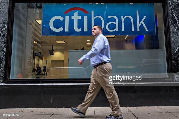 A pedestrian walks past a Citibank branch in Chicago Illinois US on Monday Oct 5 2015 Citigroup Inc is expected to report quarterly earnings on...